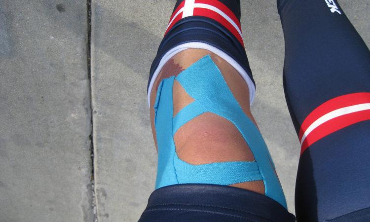 athlete wrapped knee with kinesio tape