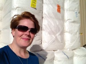 me in front of a few bales of cotton